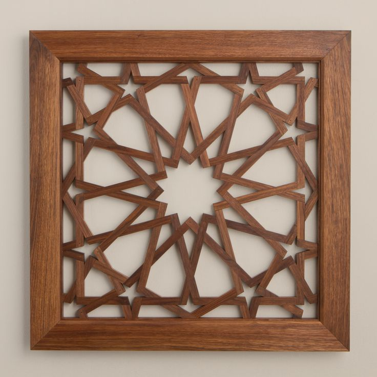 Al Shams: Recreated in beautiful American black walnut, this modern interpretation has been hand-crafted by Alan Adams. In a technique he developed, the individual wood pieces were carefully cut and assembled to resemble a woven pattern, typical of Islamic geometric design. Once carefully assembled, Al Shams was hand finished with natural oils and then sealed with beeswax.