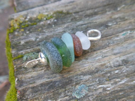 Handmade genuine sea glass jewelry. Stone cairns are often used to mark hiking trails in areas where there are no trees. It is tradition for each person that passes by to add another stone to the top of the cairn to counteract the effects of winter weather. I use my cairn pendant