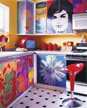 love the idea of paintings and pictures on kitchen cabinets. almost too cool