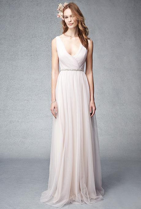 A blush pink, shirred multi-tone tulle V-neck bridesmaid dress | @m_lhuillier | Brides.com
