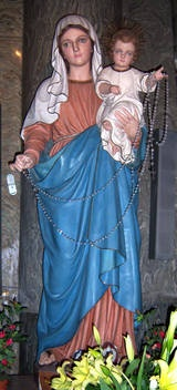 Our Lady of the Rosary prayer.  A statue of Our Lady of the Holy Rosary in the Basilica of Santa Maria sopra Minerva in Rome, Italy.