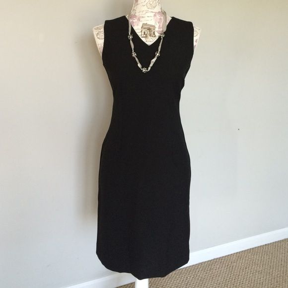 Old Navy Stretch black dress size 1 Old Navy Stretch black dress size 1. Perfect for the office! 48.5%polyester , 48.5% Rayon 3% Lycra Spandex made in Turkey. Hidden zipper, form fitting. Small slit in back Old Navy Dresses