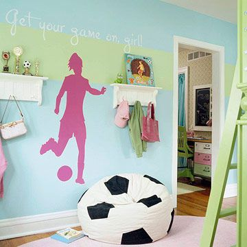 A common love of soccer sets the theme for this room shared by two girls. The athletic theme is paired with fresh, feminine colors such as pink and mint green. An adjoining space serves as a study hall but stays separate from the sleeping quarters.