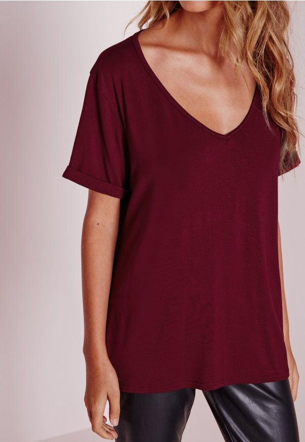 """Good things come in small packages. Shop our Missguided Petite range, for babes 5""""3 and under.   Update your wardrobe staples with this chic petite V neck boyfriend t-shirt in on point burgundy. Its loose fit, soft jersey fabric and V n..."""
