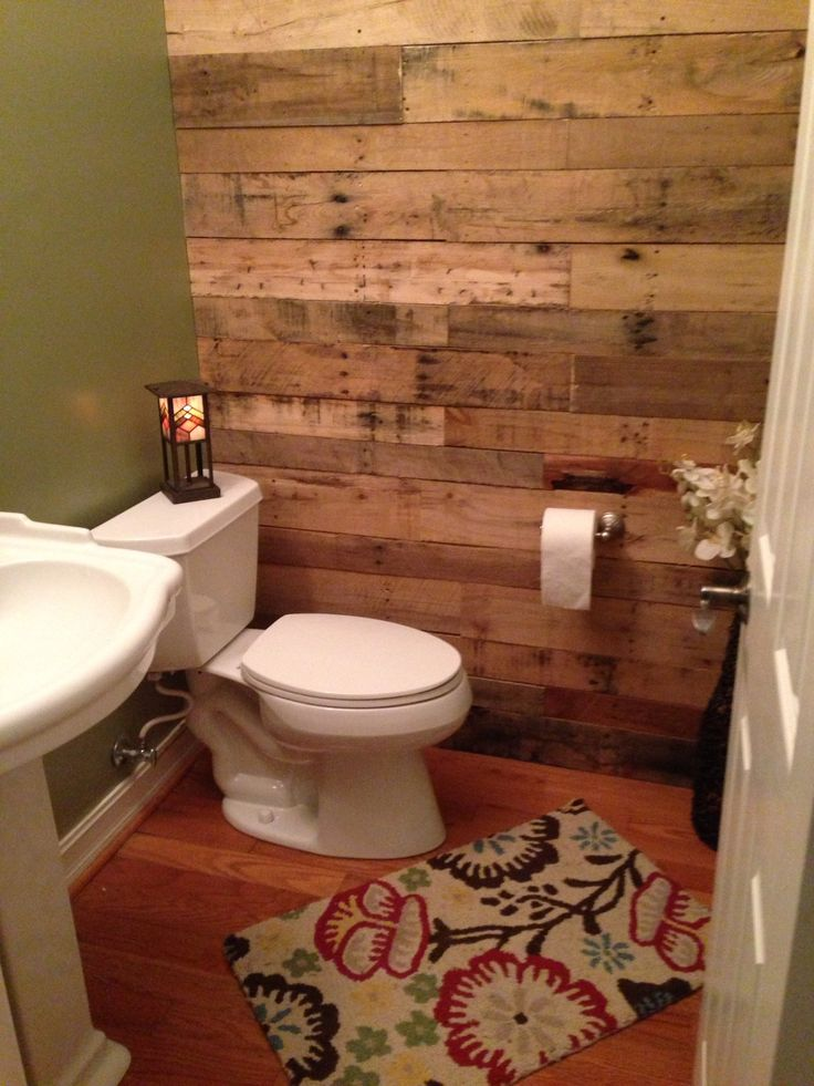 *or we could put it on the back wall like this? an get white tiles for the floor* My new #bathroom! Loving the #pallet #wall.