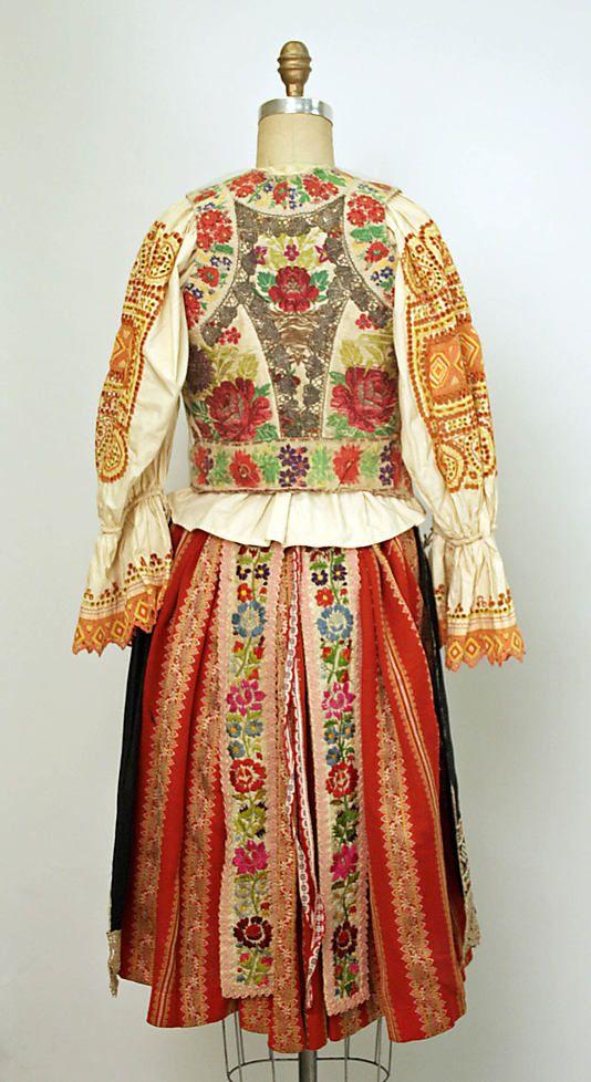 Eastern European ensemble c. 1800 - 1955. Silk, cotton, wool. Rear view.