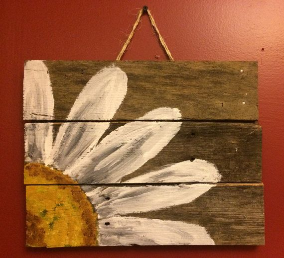 This is reclaimed wood from an old pallet. 11x14 Painted with a simple floral daisy. Will make a great accent in the home. We have 3 of these