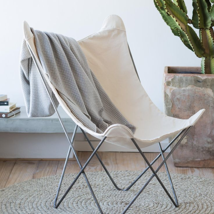 The butterfly chair is back this season, but to make it work in the home and to take off the out-doorsy edge, drape it with a soft, quality throw. It's more homely and more comfortable.