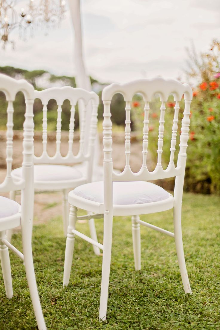 The white ceremony chairs