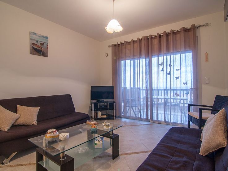 Rethymno apartment rental - The comfortable living room, where you can rest after your day on the beach!