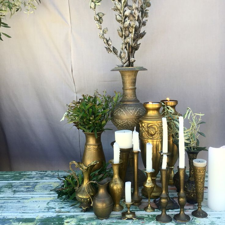 Vintage tarnished wares for hire. Eclectic mixes of vessels and candle sticks on your table. Its the stress free way to decorate your wedding or event.