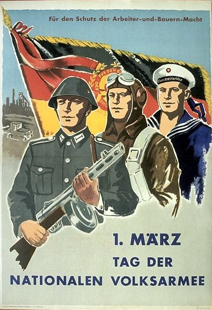 """For the protection of the power of workers and farmers. March day of the National People's Army."" Seems to be early days of the DDR."
