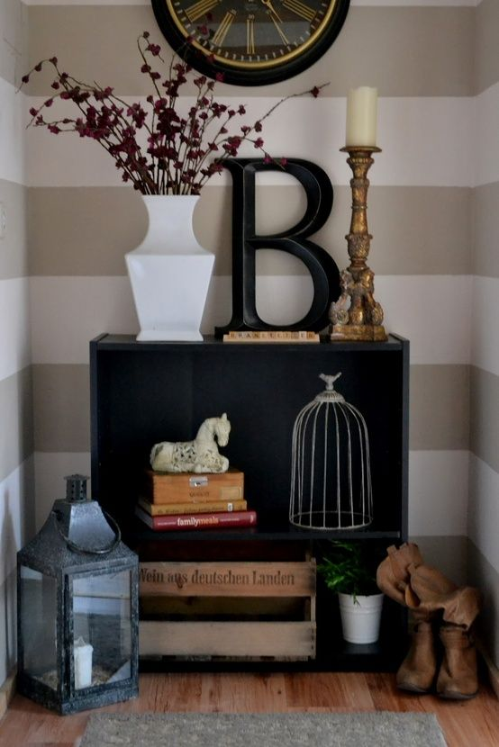 I love the walls and decor and would make for a great entry nook that blends in to a hallway or something
