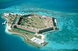 Dry Tortugas~ 70 miles west of Key West. It was used in the civil war as a fort, then later a prison that housed Dr. Samuel Mudd in 1869.