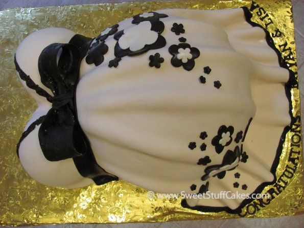 Pregnant belly cake....like the folds in the skirt.