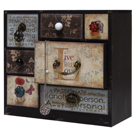 Weathered multi-drawer jewelry chest with decorative knobs and typographic detail. Product: Jewelry chestConstructi...