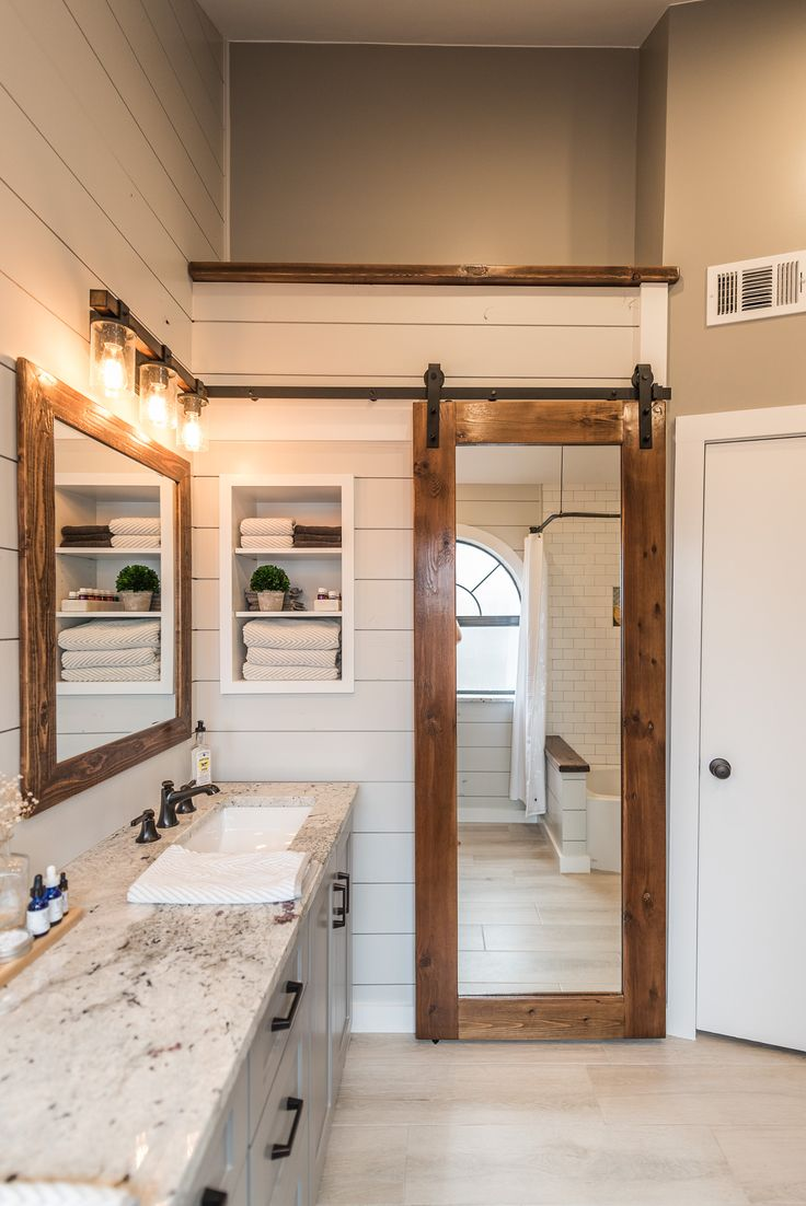 Modern Farmhouse Bathroom - Before & After by Irwin Construction in Denton, TX. Shiplap, custom cabinets, subway tile, woodgrain tile, barn door.