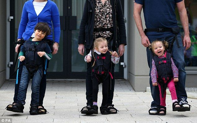 A harness that allows disabled kids to stand and walk with the help of their parents. So great.