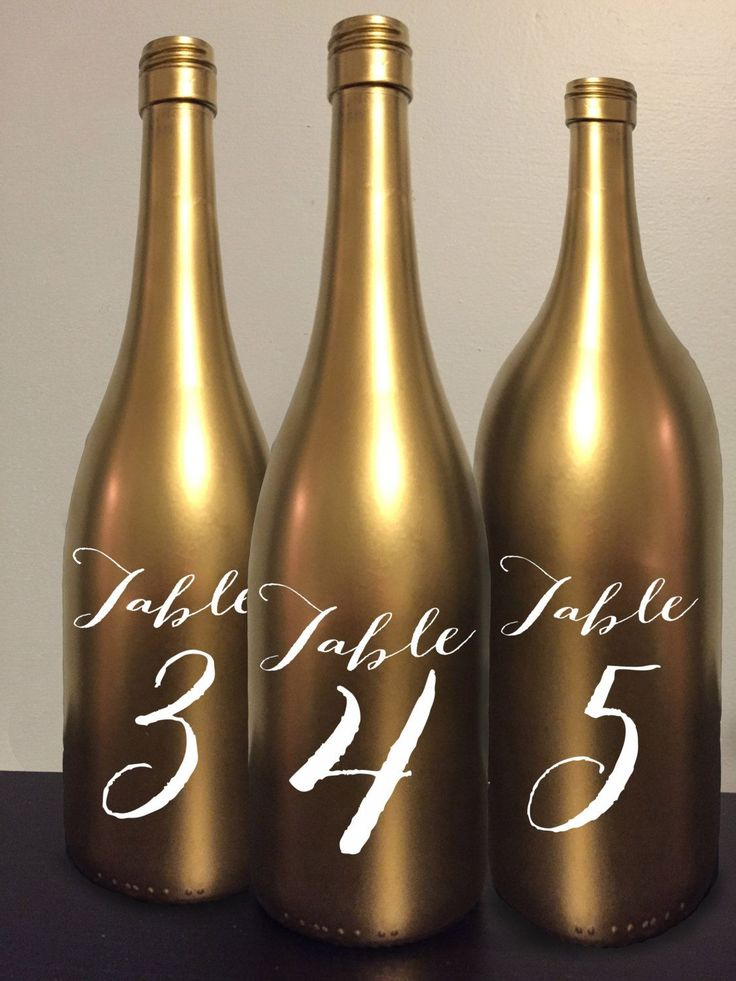Table Number Wine Bottle Gold Wedding Centerpiece Reception Decor Decoration Gatsby Art Deco Vintage Chic Elegant Fun glitter new years eve by GetHappyDesign on Etsy https://www.etsy.com/listing/264738872/table-number-wine-bottle-gold-wedding