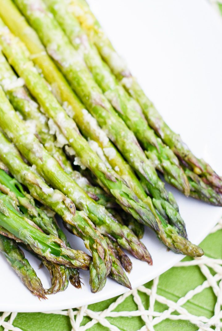 Lemon Roasted Asparagus - This quick and easy roasted lemon parmesan asparagus is the perfect way to brighten up this tasty spring vegetable! Plus, it only takes 15 minutes to get on the table!