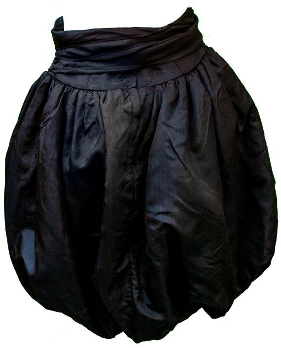 Description: 1960s Black Acetate Bubble Skirt with Attached Ribbon Tie at Waist. Brand: Gunne Sax. Condition: Good. Garment is in condition consistent with age. Garment has one mended tear, but not easily visible due to hang/volume of skirt. Estimated Sizing: Womens Small to Medium  skirt measures snug 28 waist, up to 54 hips. 34 to 66 elastic hem opening Total length of skirt is 25.  Closure: Plastic zipper at Waist, Attached Ribbon Tie.  Trying on: If you are in Los Angeles, an appoint...
