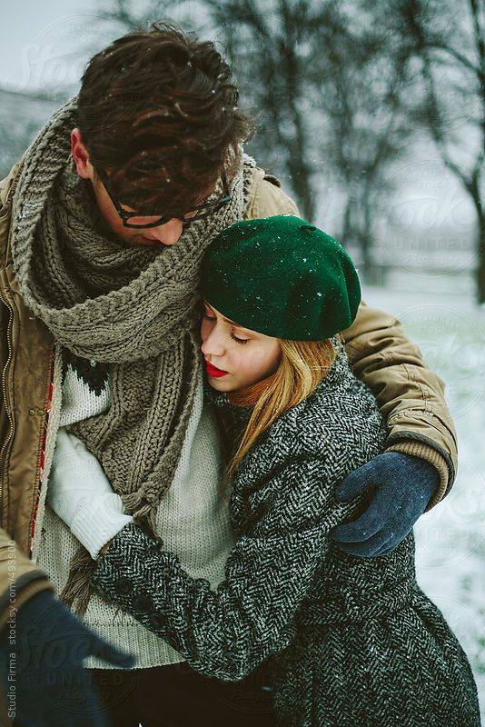 Young love couple in the park in winter time.