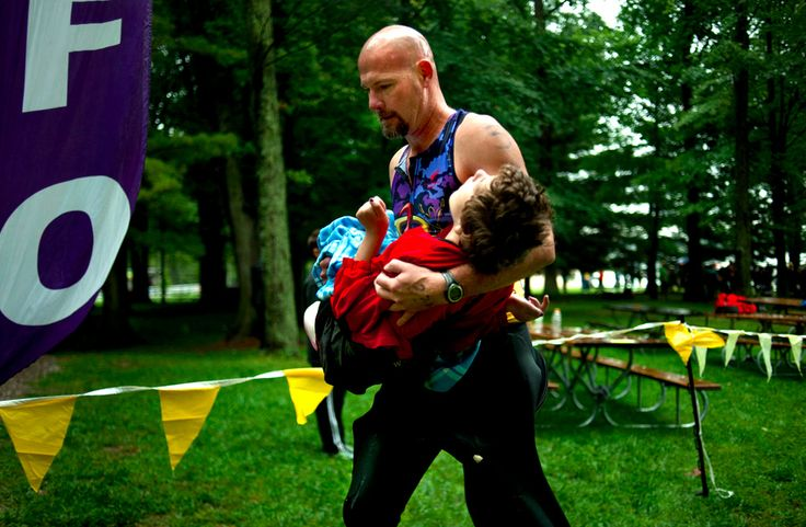 """Dad Runs Triathlon While Carrying Daughter Suffering From Cerebral Palsy.    """"She is my heart and I am her legs, though someday she might not physically be able to be there with me, she will always be in my heart, quietly cheering me on."""" — Rick van Beek"""
