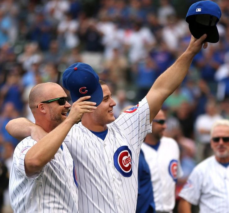 September 16, 2016. David Ross and Anthony Rizzo join the rest of the Cubs in saluting the Wrigley fans before Friday's game against the Brewers.  Chris Sweda / Chicago Tribune