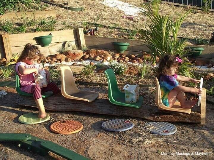 """""""Bus"""" for imaginative play. Looks like it's made out of a log and seats"""