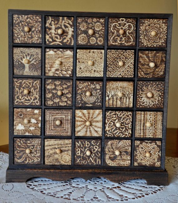 25 drawer chest of drawers, decorated with pyrography (woodburning)