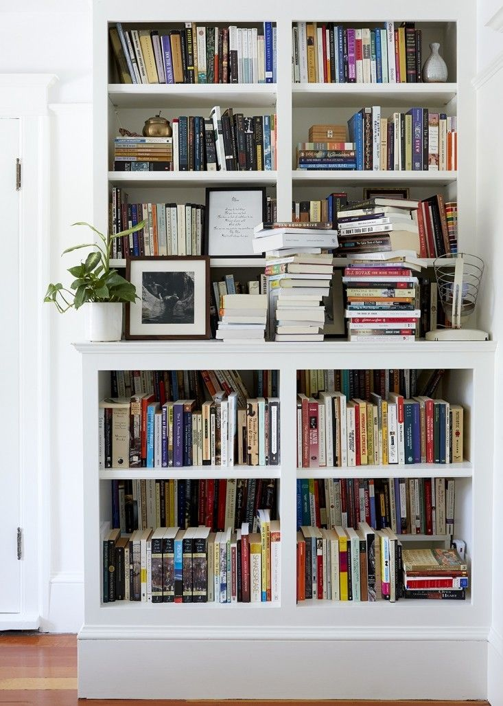Chabon Waldman Bedroom Bookshelf/Remodelista *what a great idea for double deep bookcases * Ayelet and Michael spec'ed custom-built two-tiered bookshelves with risers to allow for an accessible back row.