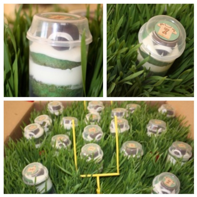 Football themed party treats... Pushpop Mini cakes layered with Oreo crumbles for dirt and topped with a football fondant. Placed in a flat of wheat grass to mimic a football field.