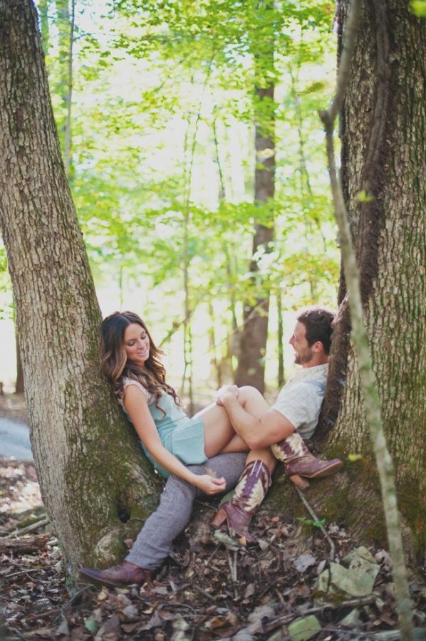 Rustic engagement pics, cowboy boots, forest, campfires