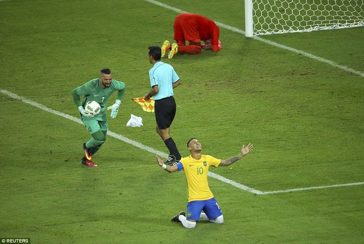 Goalkeeper Weverton races towards Neymar who sinks to his knees after he won the…