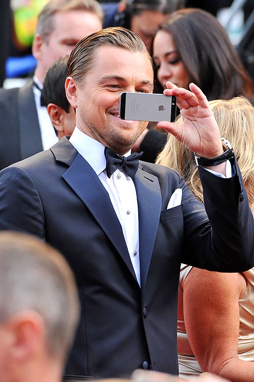 leonardodicrapio:  The iPhone strikes again: Leonardo DiCaprio on the red carpet at the 86th Annual Academy Awards, March 2nd 2014