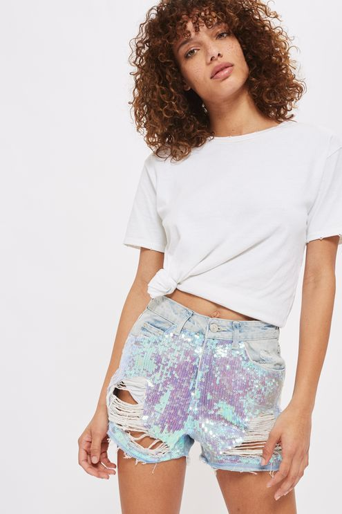 A '90s style gets a modern twist with these unique Mom shorts. In a mid-stone wash, they come detailed with small silver sequins.