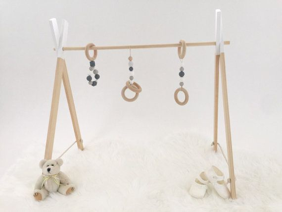 Handmade wooden play gym made from quality raw pine timber and non toxic water based paint. Made using a combination of wooden, silicone and