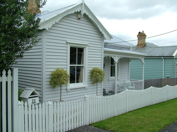 """polished"" weatherboard house"