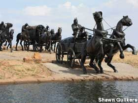 Oklahoma Land Run Monument The Oklahoma Land Run Monument is a series of giant bronze sculptures which depicts the Land Run of April 22nd, 1889 that opened Oklahoma, Indian Territory up to homesteading by settlers. The monument, which sits on the banks of the Bricktown Canal in Oklahoma City, depicts dozens of horses, wagons, soldiers, and cowboys in a race to settle the newly opened lands.
