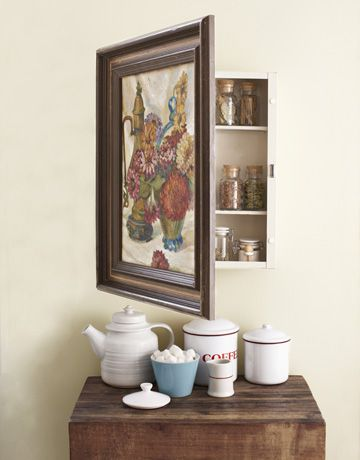 Hidden cabinet storage behind a vintage (or not) painting. This could be cute for many types of storage. I'm loving this example of using it for spices because I need a good space to keep mine that isn't stuffed up in a high cabinet where they're harder to easily access.