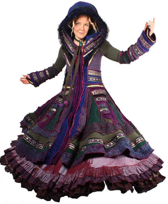 Goldeneye is a grandiose treasure coat festooned with yards upon yards of golden vintage trim. I love the palette of moss and amethyst with turquoise undertones. I pulled out all the stops on this glorious treasure coat to make it a show-stopping heirloom. Its got a hand-knit Fraggle brim and a fancy dragon tail. It has a nearly 20 foot hem. Truly wondrous indeed. In the photos Im wearing a Moresca Gitana skirt underneath. Those ruffles are not part of the coat, but you can get a skirt of…