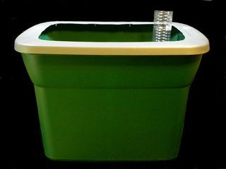 super legit 'sub-irrigated planters' - awesome for patio/rooftop gardens and made from plastic tubs and milk jugs!
