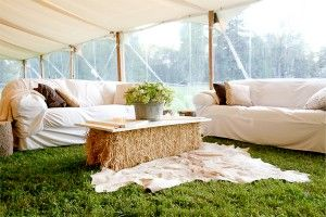 Chill zone, hay bales, comfy sofas, Summer wedding
