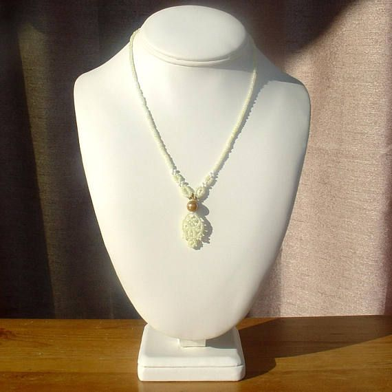 Check out this item in my Etsy shop https://www.etsy.com/listing/541459571/white-or-light-yellow-necklace-seed