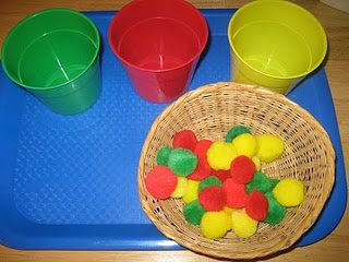 """Sorting red, green, and yellow apples by color (or size). If you wanted to incorporate fine motor, you can have your children use tongs to pick the """"apples"""" up!"""