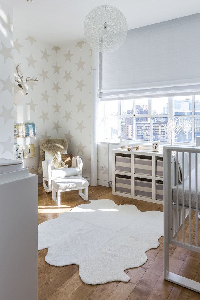 white, cream, and gold for baby's nursery - love the wall of gold stars in this neutral color palette!