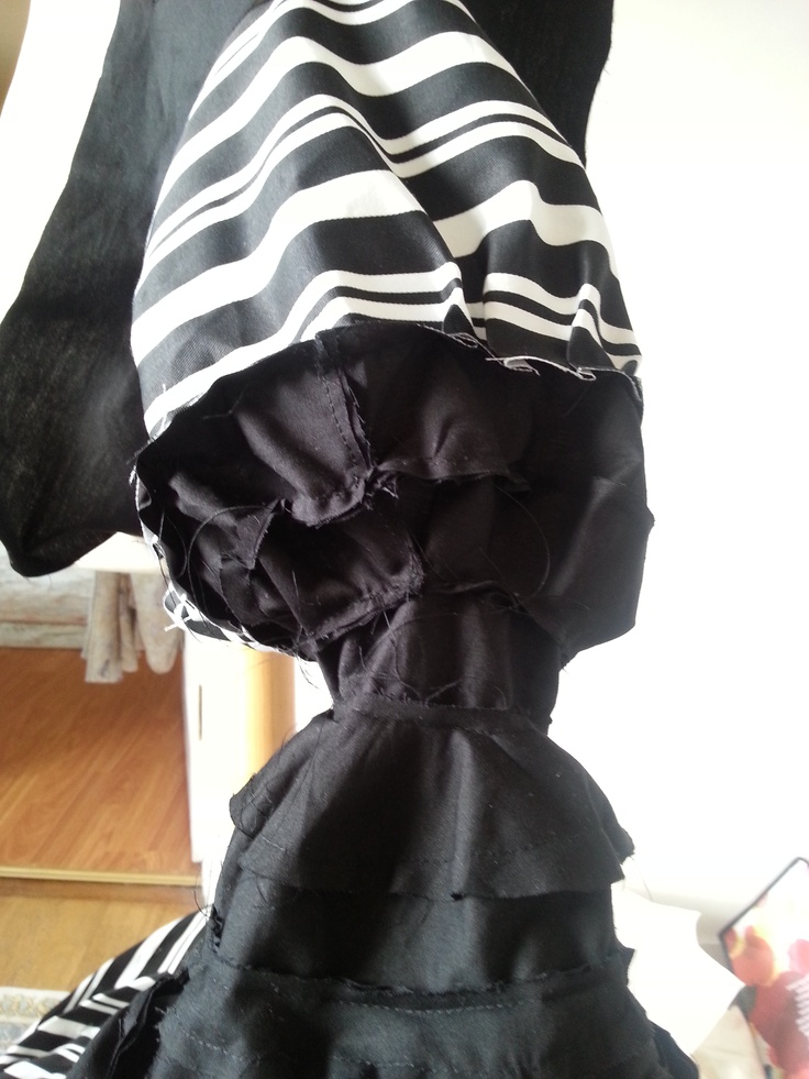 sewn one sleeve to the bodice underneath.