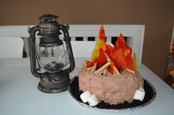 My Son's Camp Fire Cake. I crushed red, yellow and orange suckers.   Spread them out on lightly greased tinfoil on a cookie sheet.  Baked them at 350 until fully melted. Between 7-11 minutes. Let the candy cool and broke it apart to create the fire.