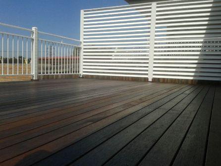 Feast Watson wet look deck on new merbau decking