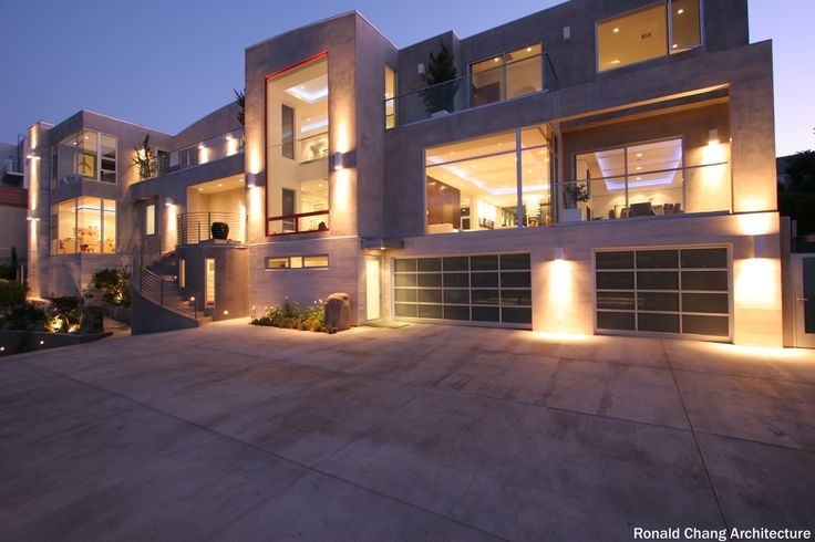 Very modern home exterior with owners who certainly did for Large front windows house